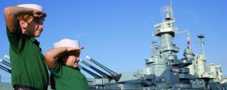 Kids salute the Battleship North Carolina