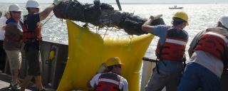 A cannon is recovered from the wreck of Blackbeard's flagship, Queen Anne's Revenge