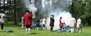 Re-enactors fire a cannon at Alamance Battleground