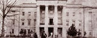 Governor David S. Reid stands in front of the N.C. State Capitol, circa 1861