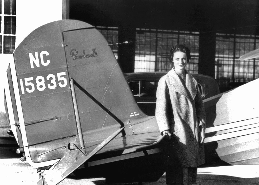 Thaden and her Beechcraft Model 17 Staggerwing airplane. Image from the Raytheon Corporation.