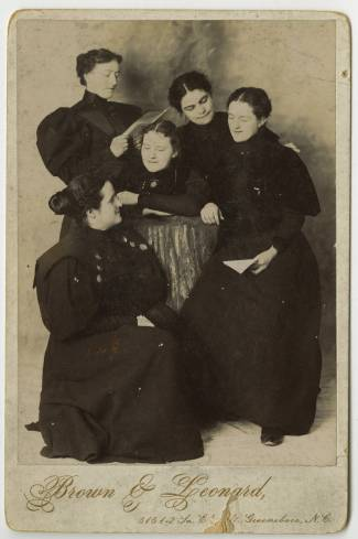 A group of five UNC Greensboro students pose for a picture in the 1890s. Image from UNC-Greensboro Libraries.