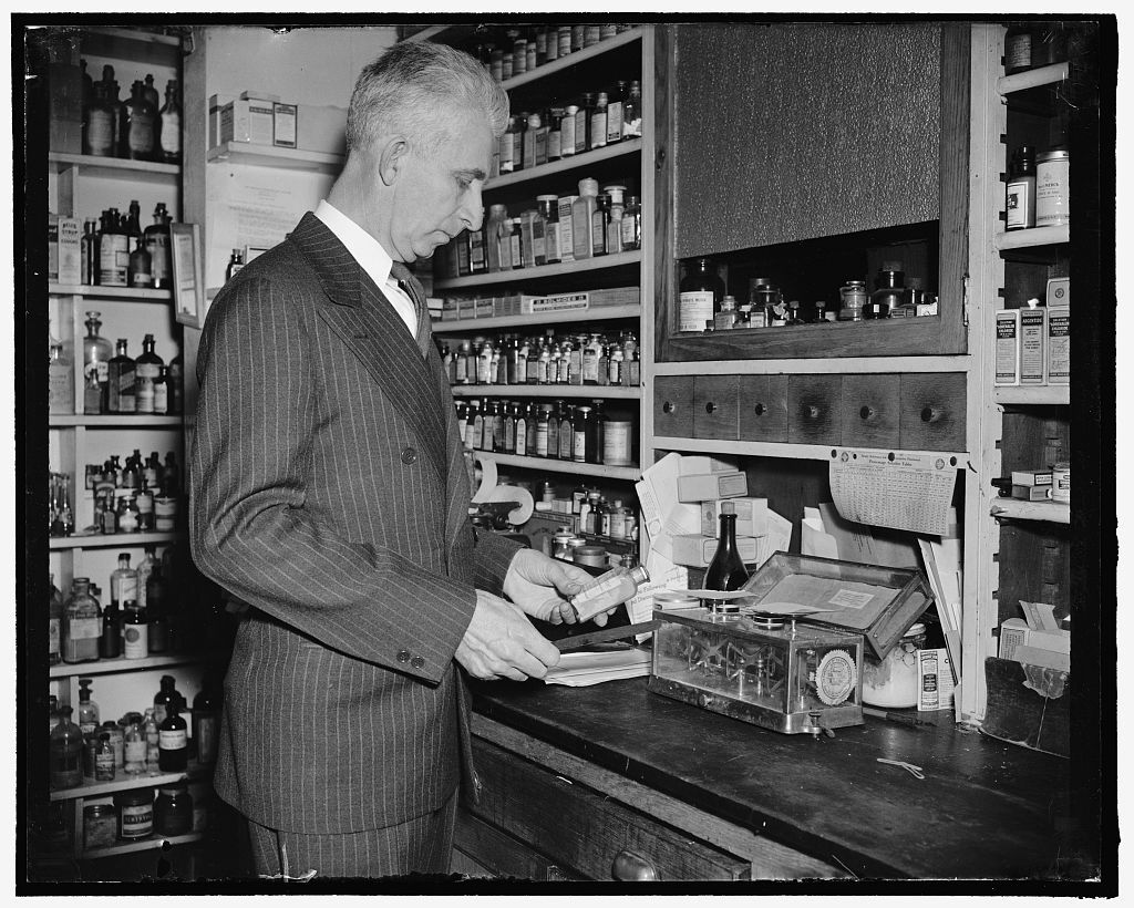 Durham in his Chapel Hill pharmacy prior to his election to Congress. Image from the Library of Congress.
