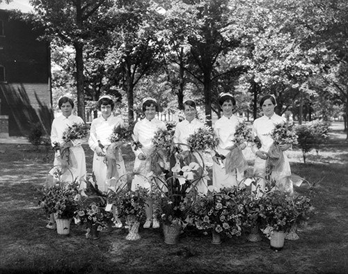 Nurses graduate from a training program in 1930. Image from the State Archives