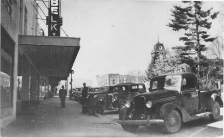 Cars in front a Belk store in the 1930s in Brevard. Image from the Transylvania County Public Library