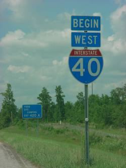 A sign marking the beginning of I-40 in New Hanover County, circa 2001. Image from the State Library.