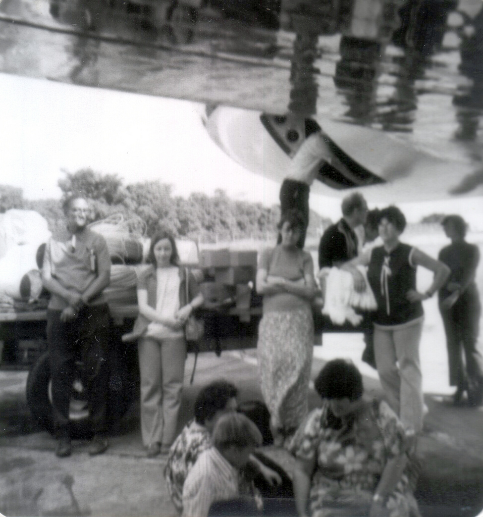 Ijames (far left) waits with a group of other Peoples Temple members while a plane is refueled on their first trip to Jonestown.