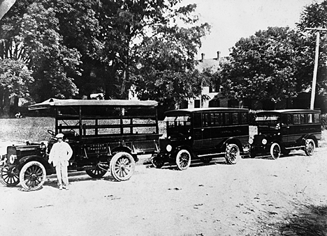 Early school buses manufactured by the Corbitt Truck Company  in Henderson. Image from the State Archives.