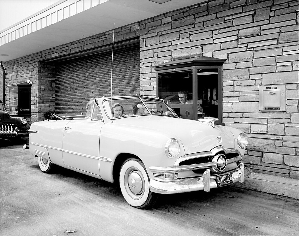 Pulling up to the Wachovia Bank drive-through at Cameron Village in 1950. Image from the State Archives