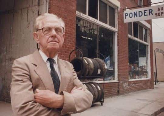 Sheriff E. Y. Ponder in front of his downtown Marshall store, circa 1992. Image from the Asheville Citizen-Times.