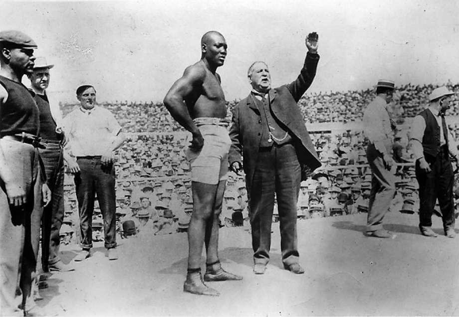 Jack Johnson prepares to defend his World Heavyweight Champion title. Image from PBS.