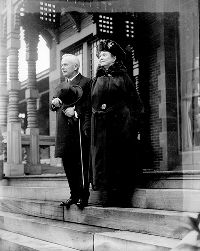 Gov. Bickett and his wife stand on the steps of the Executive Mansion.