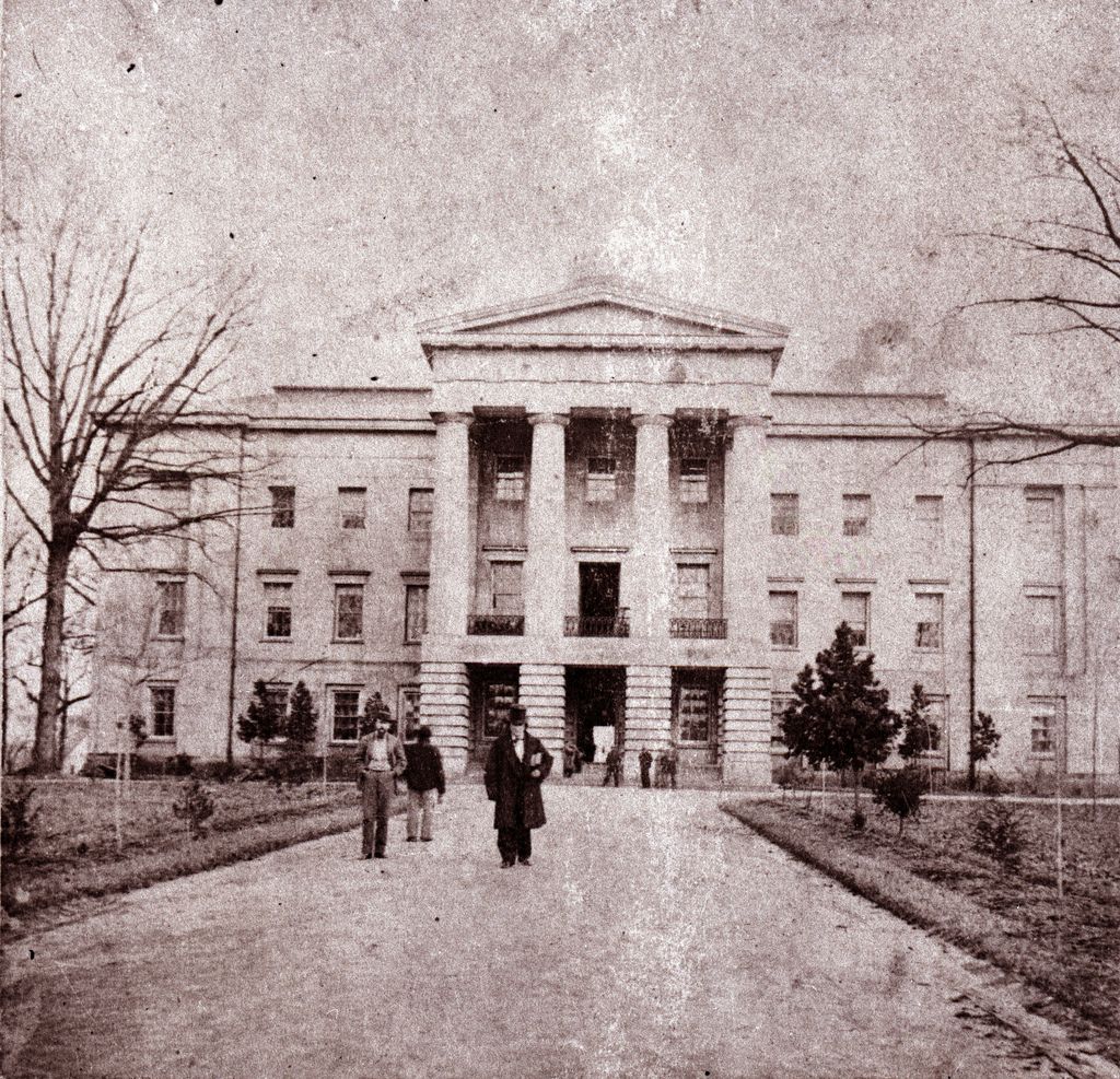 Then former Governor David Reid (in top hat, center) in front of the State Capitol, circa 1861. Image from the State Archives.