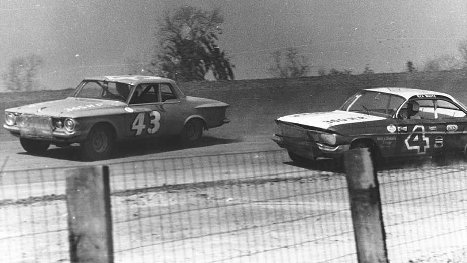 A NASCAR race on a dirt track during the 1960s. The number 43 car belongs to Richard Petty. Image from NASCAR.