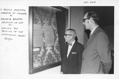 L. Quincy Mumford (left) views an exhibit on the printing of the Constitution with Archivist of the United States James B. Rhoads. Image from the National Archives.