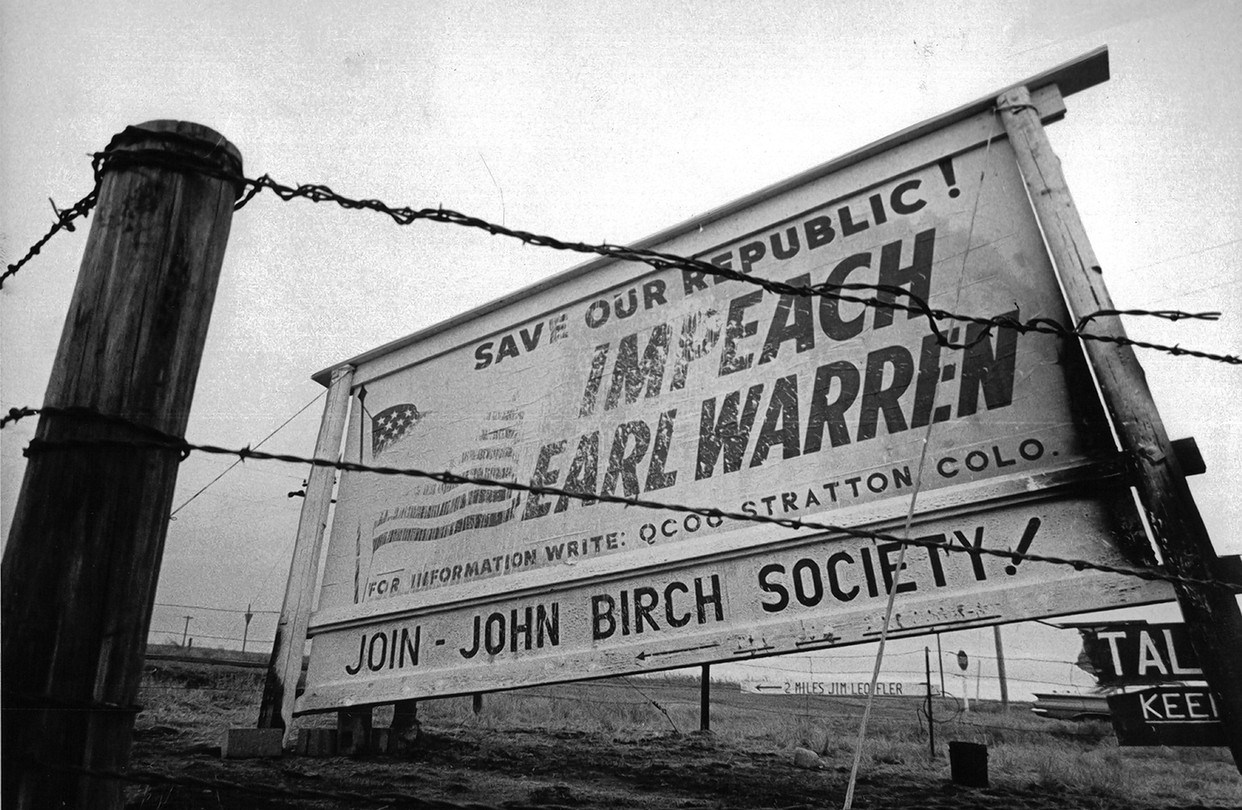 A billboard from the society encouraging the impeachment of Chief Justice Earl Warren. Image from Getty Images.
