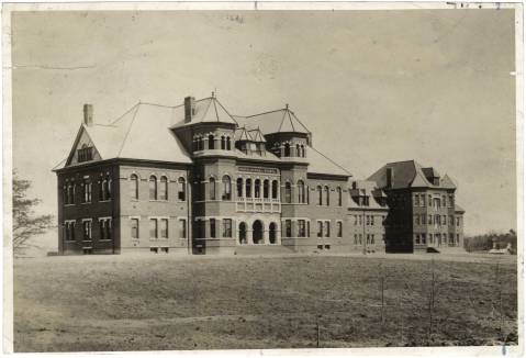 The Main Building and Brick Dormitory at UNC Greensboro, circa 1892. Image from UNC-Greensboro Libraries.