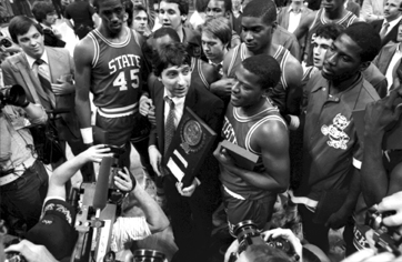 Coach Jim Valvano and members of the N.C. State men's basketball team celebrate after their 1983 championship win. Image from the State Archives and copyright the News & Observer.