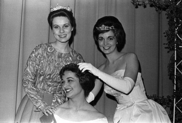 Fletcher (left) looks on as Carolyn Byrd is crowned Miss Raleigh in 1962. Image from the News & Observer