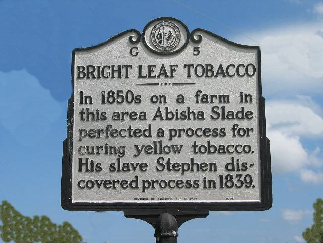 Bright Leaf Tobacco - 1n 1850s on a farm in this area Abisha Slade perfected a process for curing yellow tobacco. His slave Stephen discovered process in 1839.
