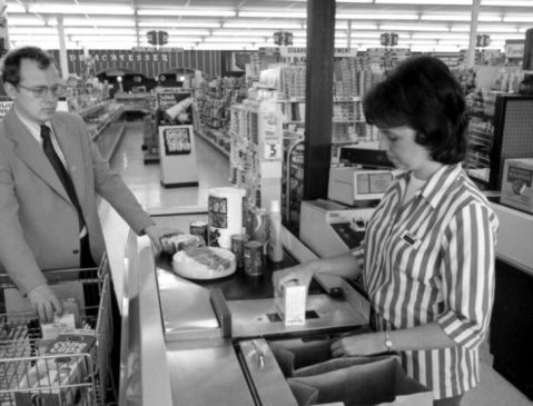 A clerk in Troy, New York scans an item with a barcode in the mid-1970s. Image from Dayton History.
