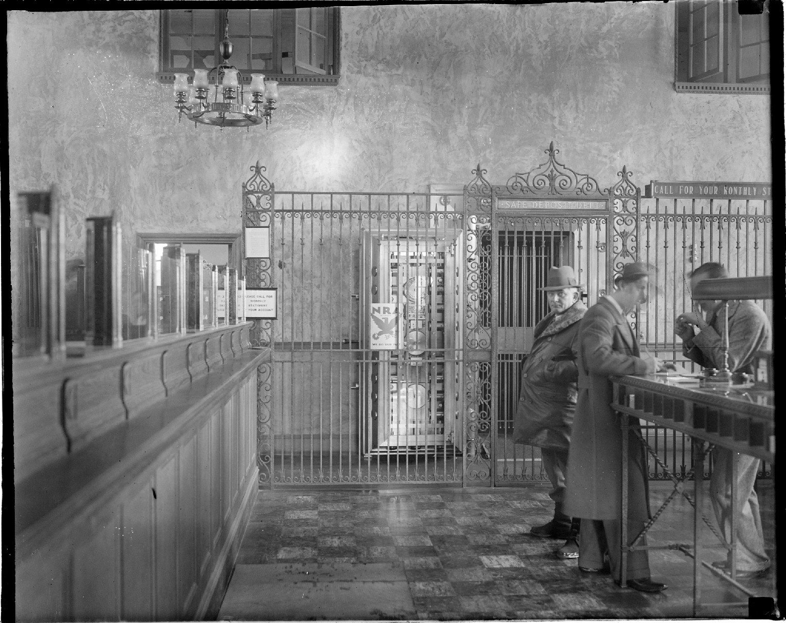 A man prepares to rob a bank in Massachusetts, circa 1934. Image from the Boston Public Library.