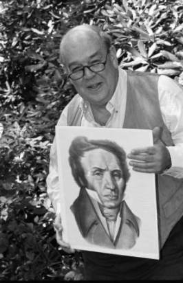 Famed journalist Charles Kuralt holds a portrait of Michaux at Grandfather Mountain in 1994. Image from the UNC-Chapel Hill Library