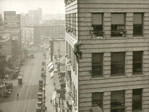 Srother scales a building in downtown Los Angeles