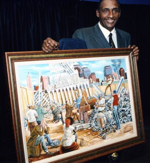"Barnes with his painting ""In Remembrance."" Image from the Barnes Family Trust."