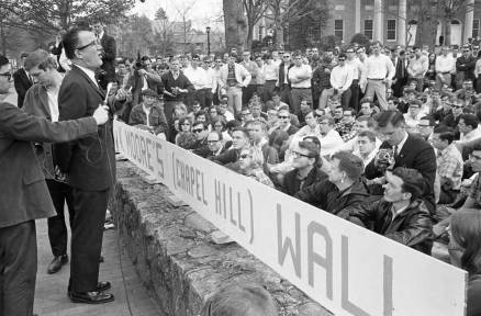 Frank Wilkinson speaks to UNC students from the Franklin Street sidewalk in March 1966. Image from the State Archives and copyright News and Observer.