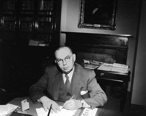 Gill at his desk at an unknown date. Image from the State Archives.