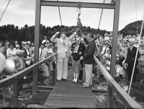 Umstead (center, behind girl) dedicates the bridge with developer Hugh Morton (front right) and others. Image from UNC-Chapel Hill Libraries.
