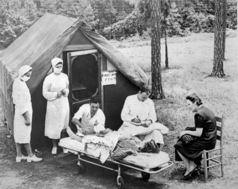 Admission staff examines a young woman at the Hickory Emergency Polio Hospital in 1944. Image from the N.C. Museum of History.
