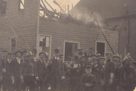 The Press Building burning during the race riots. Photo from NCpedia.