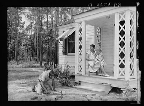 A homesteader lays a brick walk at Penderlea. Image from the Library of Congress.