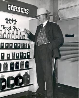 Sam Garner, father of Texas Pete founder Thad Garner, picks up a bottle of sauce. Image courtesy of TW Garner Food Company.