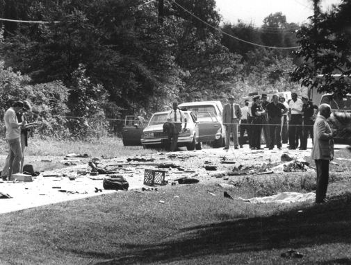 State and local authorities investigate the scene where Klenner's Blazer blew up. Image from the News & Record.