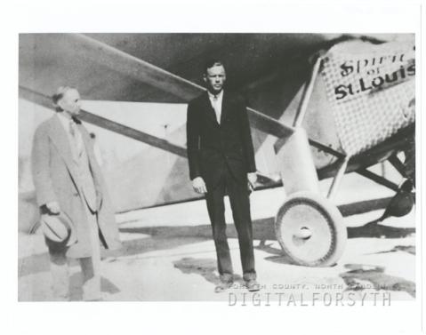 Charles Lindbergh (right) with Winston-Salem Mayor Thomas Barber posing in front of the Spirit of Saint Louis at Miller Municipal Airport in 1927. Photo courtesy of Digital Forsyth.