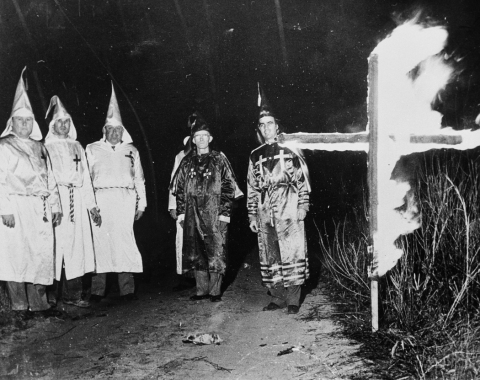 Klansmen in robes with burning cross. Image taken from  the State Archives.