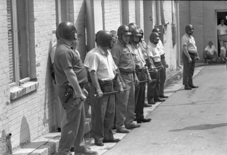 Deputized white citizens awaiting the verdict in the trial of the Teels in August 1970