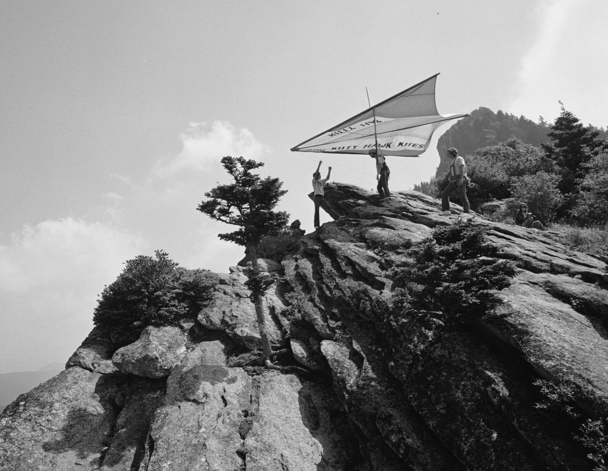 "John Harris prepares for his ""first flight"" off Grandfather Mountain. Image from UNC-Chapel Hill Libraries."