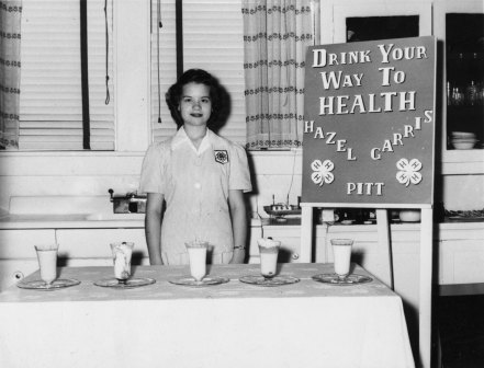 "Hazel Carris of Pitt County at her 4-H exhibit, ""Drink Your Way to Health"" during the 1940s. Image from NCSU Libraries"