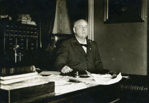 Glenn works at his desk in Raleigh, circa 1905-1909. Image from the N.C. Museum of History.