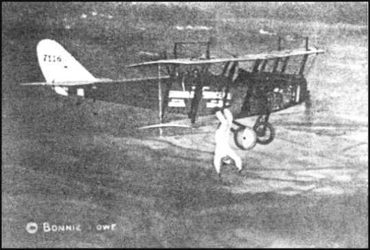 Bonnie Row hangs from an airplane by his feet in the 1920s. Image from History of Hapeville, Georgia.
