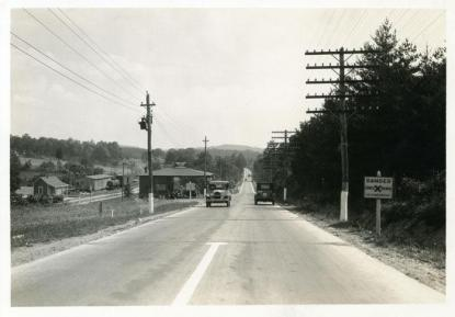 An unidentified highway lined with electric poles. Image from 1910-1920 and now in the collection of the N.C. Museum of History