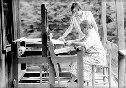 Penland founder Lucy Morgan instructs a weaver in the 1930s. Image from the UNC-Chapel Hill Library