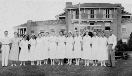 Dr. Sidbury and the nurses of Babies Hospital. Image from the New Hanover County Public Library.