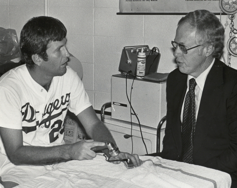 Tommy John (left) and Dr. Frank Jobe talking to each other. Photo from the Los Angeles Dodgers.