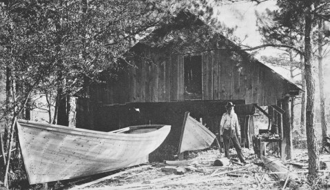 George Washington Creef at work on a shad boat at the Creef Boatworks at Wanchese, circa 1890s. Image from the N.C. Maritime Museums.