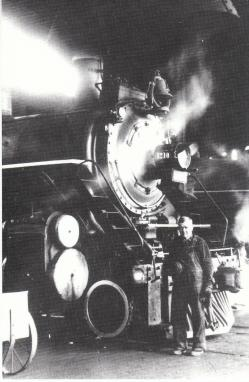 A locomotive inside the roundhouse in 1945. Image from N.C. Historic Sites